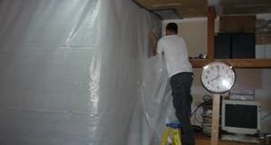 Vapor Barrier Being Installed For Mold Removal Job