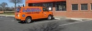 Water Damage Restoration Van Parked At Job