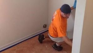 Water Damage Technician Checking For Mold Growth